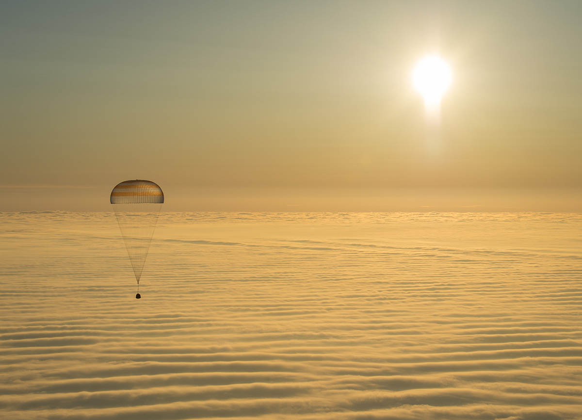 The Soyuz TMA-14M spacecraft is seen as it lands with Expedition 42 commander Barry Wilmore of NASA, Alexander Samokutyaev of the Russian Federal Space Agency (Roscosmos) and Elena Serova of Roscosmos near the town of Zhezkazgan, Kazakhstan on Thursday, March 12, 2015. NASA Astronaut Wilmore, Russian Cosmonauts Samokutyaev and Serova are returning after almost six months onboard the International Space Station where they served as members of the Expedition 41 and 42 crews. Photo Credit: (NASA/Bill Ingalls)
